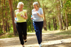 Picture of two senior females running outdoors