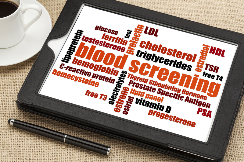 Digital tablet with words showing health screen components such as blood, cholesterol and Vitamin B.