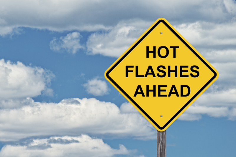 "Caution sign that says ""Hot flashes ahead""."