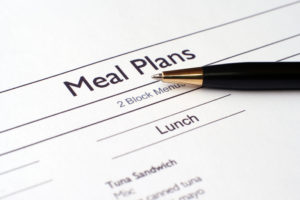 "Paper that says ""meal plan"" with food options beneath it."