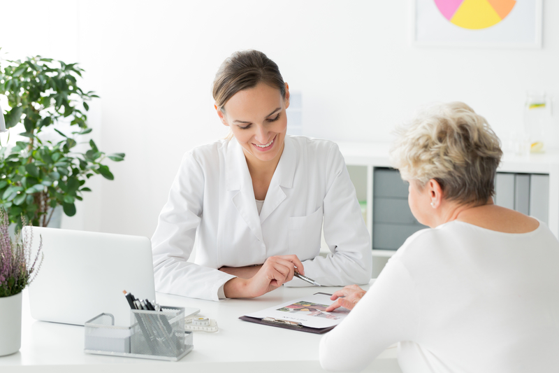 Female doctor consulting with a female patient about nutrition.