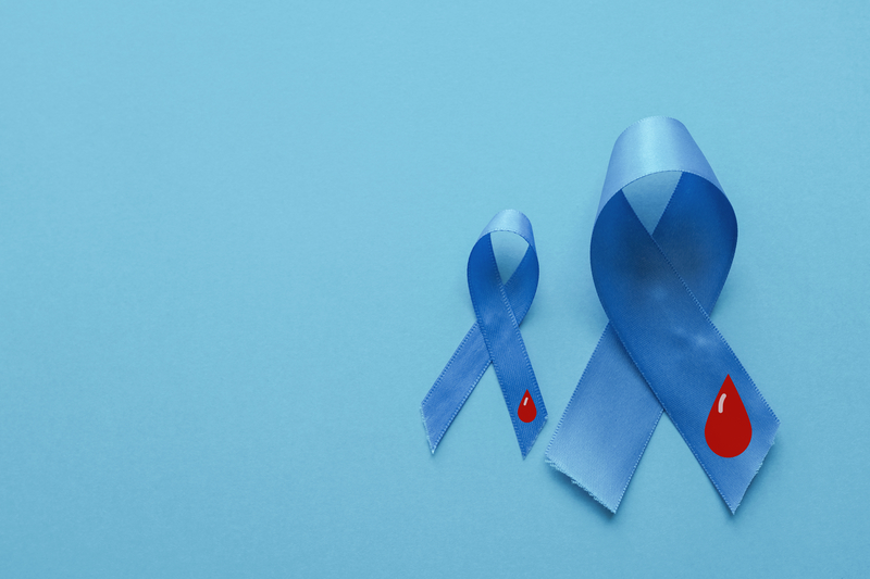 Light blue ribbons with a red blood droplet on them representing National Diabetes Month.